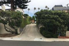 """(1/8) """"Been spraying this house for about a year or more. Look at the difference the house on the left has not been sprayed. The driveway and to the right is the house that I am spraying"""